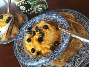 Creamy Polenta with Corn Niblets, Fresh Blueberries and topped with Honey